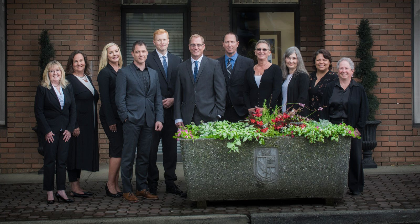 Group photo of team of lawyers and support staff at Qualicum Beach law office Marshall and Lampersons