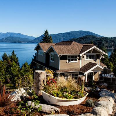 Image for Real Estate Lawyers Vancouver Island, large house with ocean view