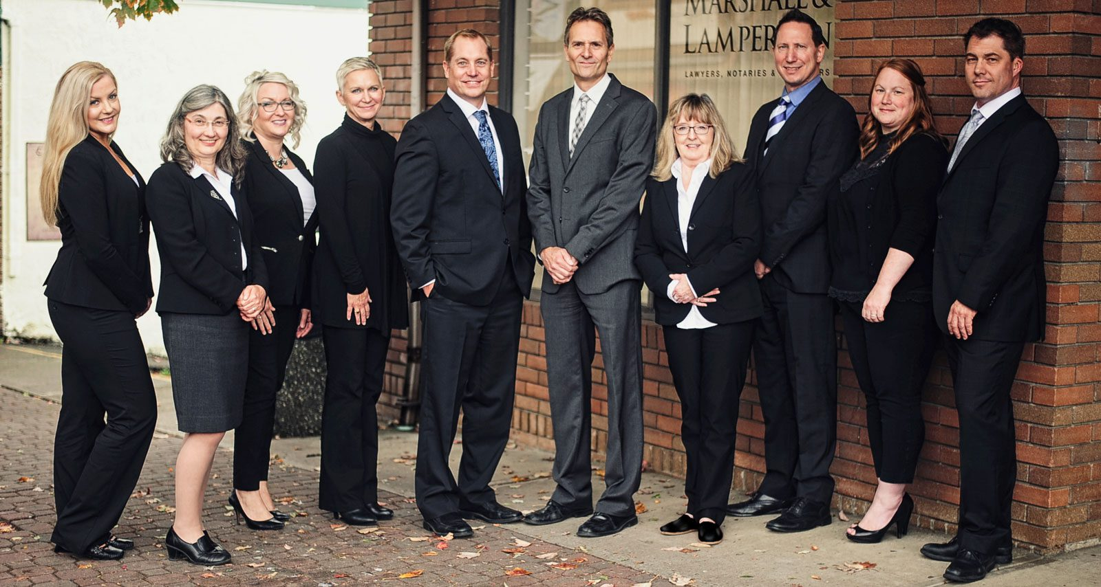Group shot of staff at Marshall and Lamperson's, Qualicum Beach law office